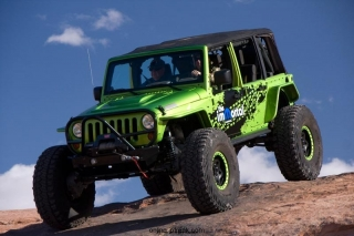 The Mopar Immortal was revealed at the 44th annual Easter Jeep Safari in Moab, Utah.  The Mopar Immortal is a Jeep Wrangler featuring portal axles, a 5.7-liter HEMI and off-road bumpers.  Military-grade portal axle ends are engineered to mate to Mopar's Pro Rock and Power Wagon performance axles and adapted to fit the suspension.  Portal axle ends provide 5 inches of lift and contain a 1.5 gear reduction.  Combined with the 4:1 transfer case, the result is a 100:1 crawl ratio.  The vehicle is sheathed in Jeep performance body armor for protection.