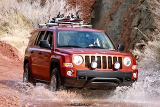 Mopar revealed the Jeep Patriot Extreme image vehicle at the 44th annual Easter Jeep Safari in Moab, Utah.  Mopar started with a Sunburst Orange Jeep Patriot model equipped with the Trail-rated off-road package and added a 2-inch Rocky Road Outfitters suspension lift, TJ 'Moab' 16-inch wheels, and BF Goodrich KM2 tires.  Additional protection is added to the front and rear fascias with custom rock rails.  Mopar added heavy-duty slush mats, Kicker audio and a roof-mounted snowboard carrier.