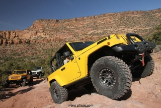 Mopar revealed the Jeep Wrangler Trail Boss image vehicle at the 44th annual Easter Jeep Safari in Moab, Utah.  The Jeep Wrangler Trail Boss was built to showcase Mopar off-road products in the brand's trail catalog.  The Trail Boss is a two-door Jeep Wrangler Rubicon that is built for serious off-road duty.  The vehicle features a half-door kit, sun bonnet, front and rear AEV off-road bumpers, a Warn 9.5ti winch, rear-tire carrier, AEV hood, 3-inch lift kit, Hutchinson Rock Monster beadlock wheels, Katzkin leather seat trim kit, slush mats and a Kicker audio system.