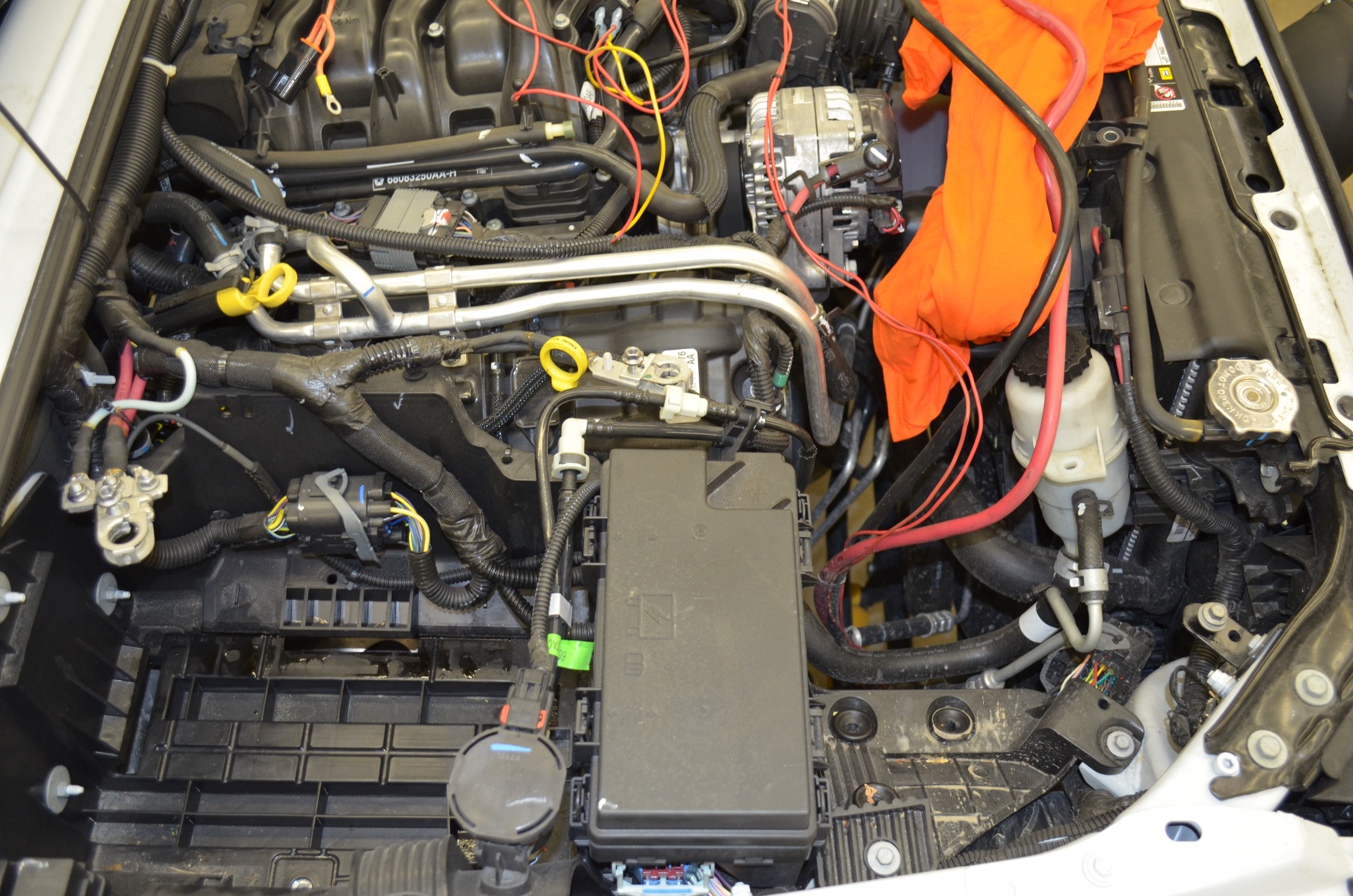 Preparing to install the dual battery system 2012 JKU. Next we removed the fuse  box.