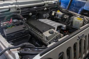Mercedes OM606 sitting in the JK engine bay for a test fit