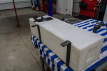 Straps made and fitted to tank, lined with foam weather sealing
